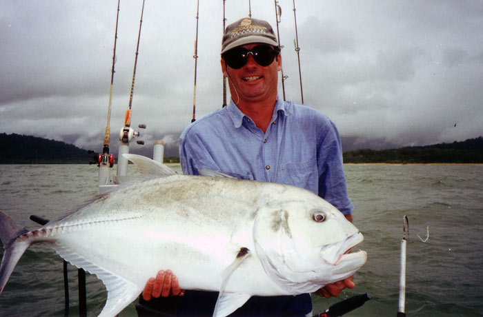 man with a giant trevally